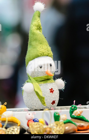 Snowman Christmas decoration on sale on a market stall - Stock Photo