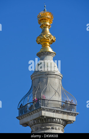 Tourists on the viewing platform at the top of the Monument column commemorating the Great Fire of London - Stock Photo