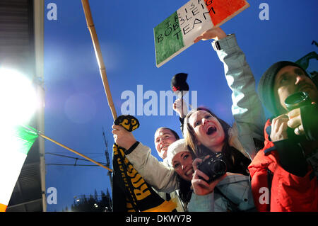 Feb 24, 2010 - Whistler, British Columbia, Canada - Ireland fans cheer during the ladies' two-man bobsled competition - Stock Photo