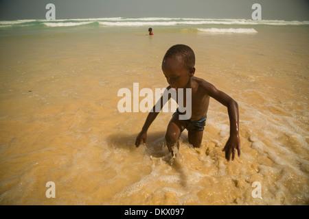 Child at Yaf beach Dakar, Senegal - Stock Photo