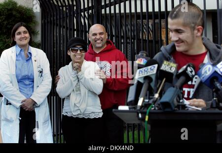 Dec 23, 2009 - San Jose, California - While MATT BLEA, right, makes a statement to journalists, his parents, JANE - Stock Photo