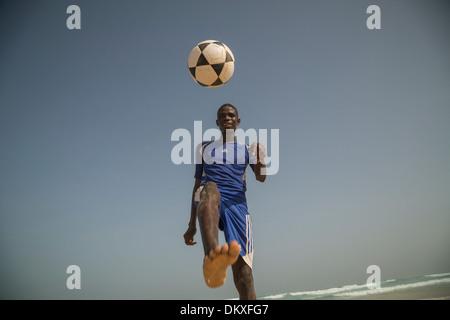 Football player on the beach in Dakar, Senegal. - Stock Photo