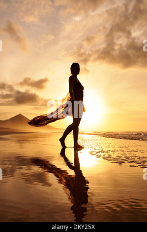 Young woman at the beach, Cofete, Fuerteventura, Canary Islands, Europe - Stock Photo
