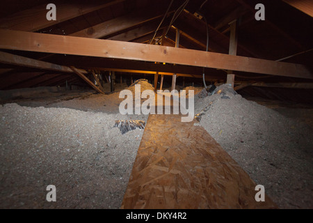 Attic insulation stock photo royalty free image 40074470 for Loose fill insulation r value