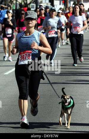 Feb 28, 2010 - Los Angeles, California, USA - Participant LARISA HAMADA of Culver City runs with her dog Mako during - Stock Photo
