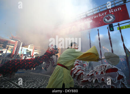 Feb 28, 2010 - Los Angeles, California, USA - Lion dancer performs as exploding firecrackers during the opening - Stock Photo
