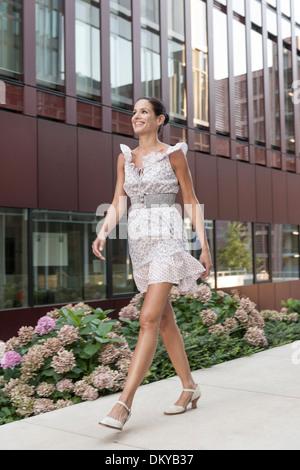 Young woman, summer dress, HafenCity, Hamburg, Germany - Stock Photo
