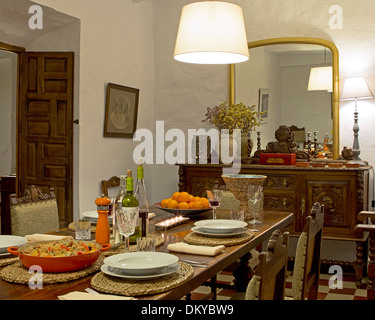 Almohalla 51, Archidona, Spain. Architect: none, 2013. Guest lounge with set dining room table. - Stock Photo