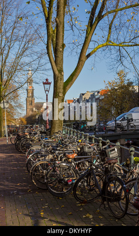 BICYCLES PARKED ON CANAL BRIDGES  AND ALONGSIDE MANY CANALS IN AMSTERDAM HOLLAND - Stock Photo