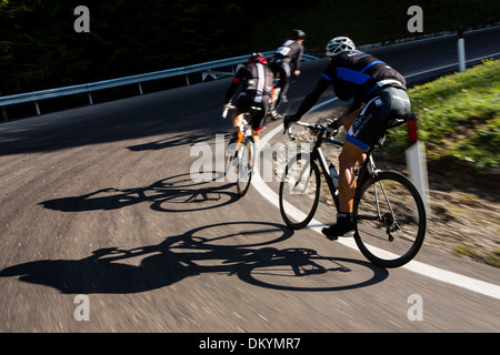 Cyclists round a corner during the Maratona dles Dolomites race in Italy, 2013 - Stock Photo