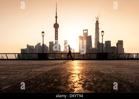 Sunrise on the Bund, waterfront, skyline of Pudong, Shanghai, China - Stock Photo
