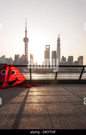 Kite at the bund, waterfront, sunrise, skyline of Pudong, Shanghai, China - Stock Photo