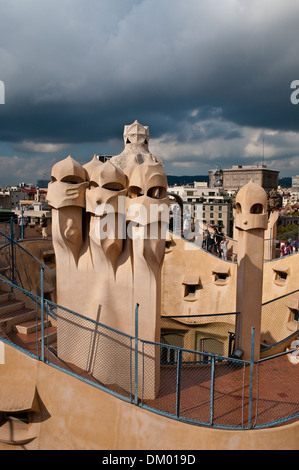 Roof sculptures, Casa Mila, or La Pedrera, by Antoni Gaudi, Barcelona, Catalonia, Spain - Stock Photo