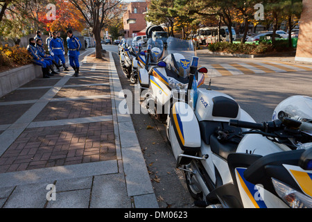 Police motorcycles parked on side of road - Seoul, South Korea - Stock Photo