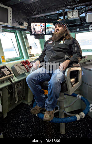 Duck Dynasty reality television star Willie Robertson sits in the commanding officer's chair during a tour of the - Stock Photo