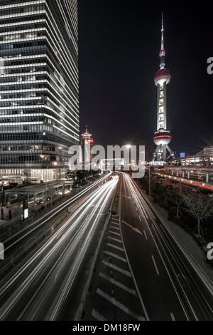 Traffic at night, Lujiazui, Pudong, Shanghai, China - Stock Photo