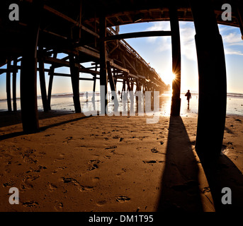 Surfer at sunset, San Clemente Pier, California. - Stock Photo