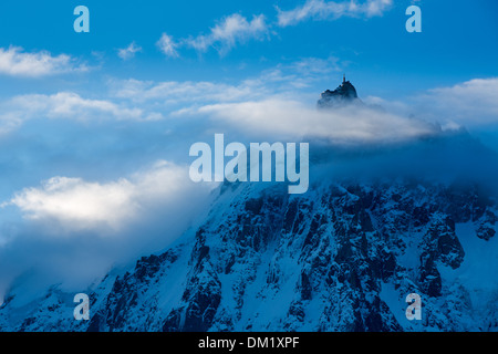 the Aiguille du Midi  appearing through the clouds, Mont Blanc, les Alps, Haute-Savoie, France - Stock Photo