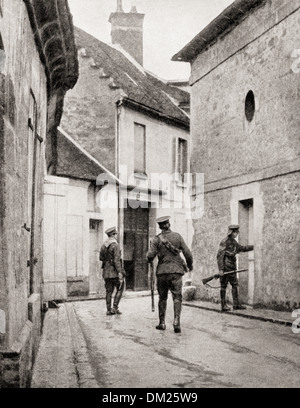 British soldiers conduct a house to house search for German enemy in a captured village in France during WWI. - Stock Photo