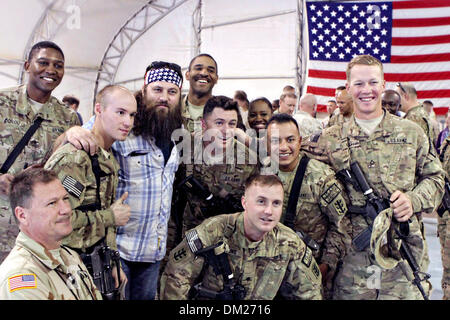 Duck Dynasty reality television star Willie Robertson poses for photos with Marines December 10, 2013 at Camp Leatherneck, - Stock Photo