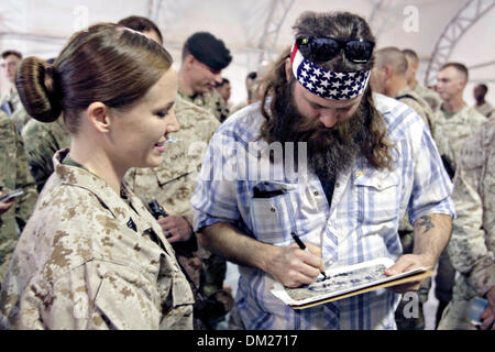 Duck Dynasty reality television star Willie Robertson signs autographs for Marines December 10, 2013 at Camp Leatherneck, - Stock Photo
