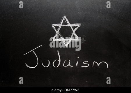 Close up of a blackboard with Judaism written on it in chalk. - Stock Photo