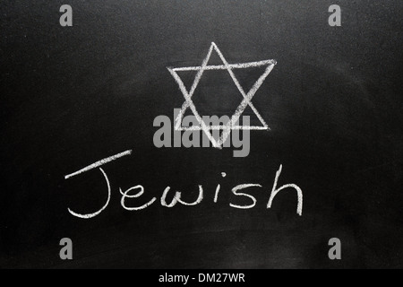 Close up of a blackboard with Jewish written on it in chalk. - Stock Photo