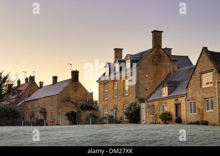 Row of Cotswold houses at sunset, Willersey near Broadway, Gloucestershire, England. - Stock Photo