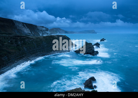 Mupe Bay at dawn on a rough winter morning, Jurassic Coast, Dorset, England - Stock Photo