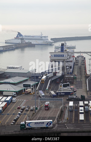 Roll-on roll-off ferries dock at the port of Dover, Kent, UK. Lorries are shown leaving the ferry - Stock Photo