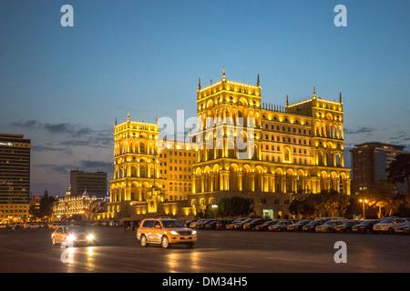 Azerbaijan Caucasus Eurasia Baku Government administration architecture avenue city downtown house travel illuminated - Stock Photo