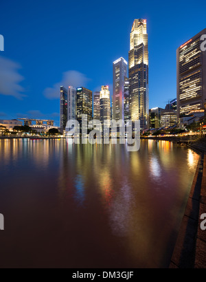 the Central Business District at night from Boat Quay, Singapore - Stock Photo