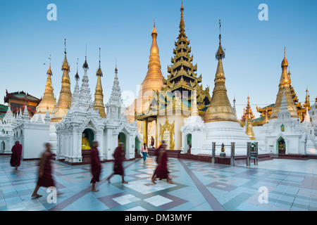 monks at Shwedagon Pagoda, Yangon, Myanmar (Burma) - Stock Photo