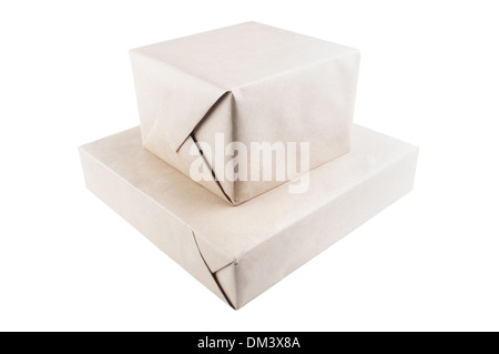 Two parcel wrapped with brown packing paper isolated on white - Stock Photo
