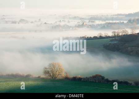 Layers of mist over the South Downs National Park near Firle in East Sussex, England - Stock Photo