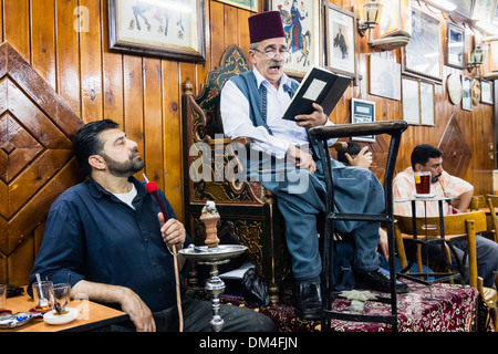 Abu Shady , the last of the hakawati the fabled storytellers of Damascus performing at Al Nawfra coffeehouse , Damascus - Stock Photo
