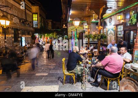 Men smoking hookah outdoor at Al Nawfara coffeehouse, Damascus, Syria - Stock Photo