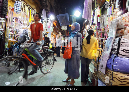 Boy with bicycle and people shopping in Al Hamadiyya Souq. Damascus, Syria - Stock Photo
