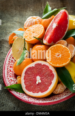 Fresh citrus fruits on rustic background, selective focus - Stock Photo