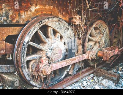 Close-up of a rusty wheel on derelict steam locomotive in Havana Cuba - Stock Photo