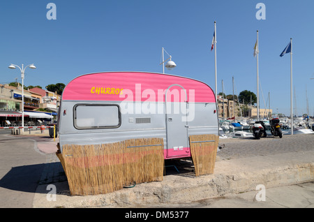 Pink Caravan used as Fast Food Stall or Food Truck Selling Churros on the Port Carry-le-Rouet Provence France - Stock Photo