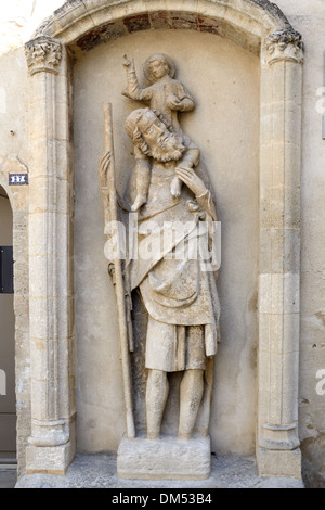 Medieval Carving, Statue of Saint Christopher (c14th), Patron Saint  of Travelers, Carrying Infant Jesus or Child - Stock Photo