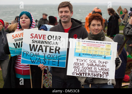 Anti toxic waste dumping signs and demonstrators at rally-Victoria, British Columbia, Canada. - Stock Photo