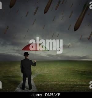 Man holding an umbrella when raining bombs - Stock Photo