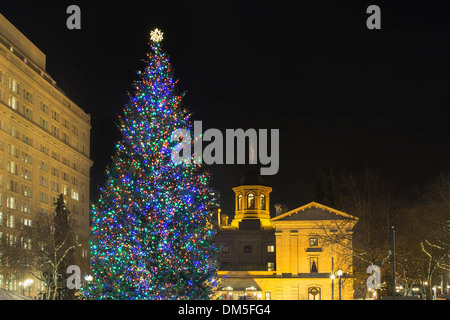 Christmas Holiday Tree at Pioneer Courthouse Square in Portland Oregon Downtown Decorated with Colorful Lights at Night