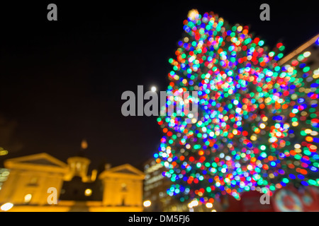 Christmas Holiday Tree with Festive Colorful Lights in Pioneer Courthouse Square in Downtown Portland Oregon