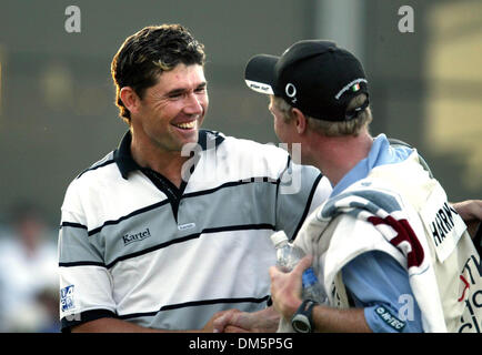 Mar 13, 2005; Palm Beach Gardens, FL, USA; PADRAIG HARRINGTON is congratulated by his caddie after winning The Honda - Stock Photo