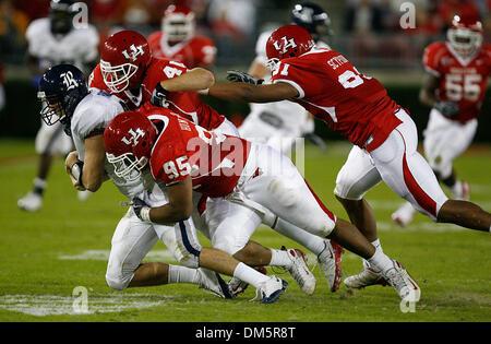 Nov. 28, 2009 - Houston, Texas, U.S - 28 November 2009: Rice quarterback Nick Fanuzzi is sacked by Houston defenders - Stock Photo