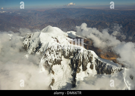 Peak of the Illimani Glacier, 6439 m, view from an aircraft, Departamento La Paz, Bolivia - Stock Photo
