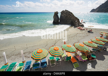 Sandy beach and colorful sunshades, Monterosso al Mare, Cinque Terre, La Spezia Province, Liguria, Italy - Stock Photo